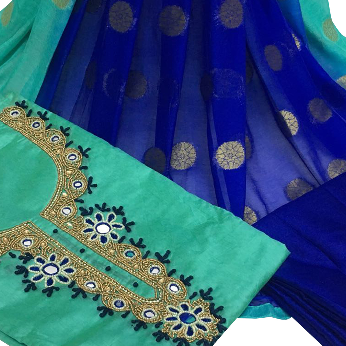 Glowing Turquoise Green Colored Partywear Embroidered Santoon Dress Material