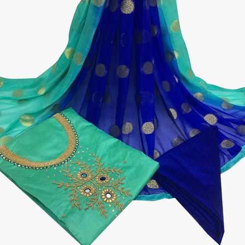 Gorgeous Turquoise Green Colored Partywear Embroidered Santoon Dress Material