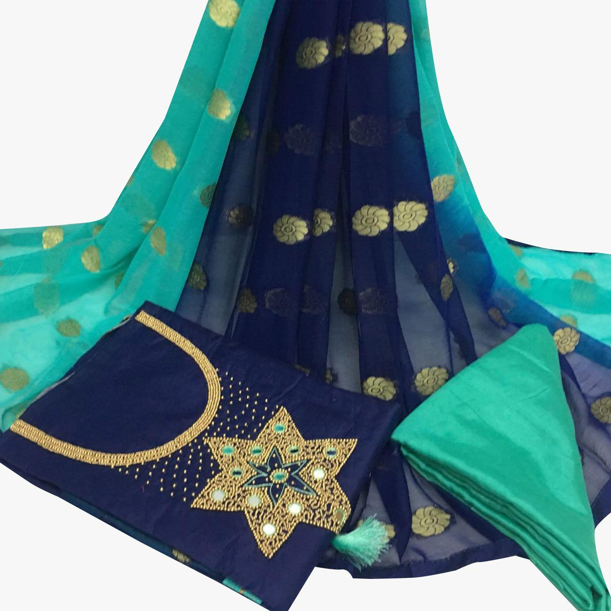 Lovable Navy Blue Colored Partywear Embroidered Santoon Dress Material