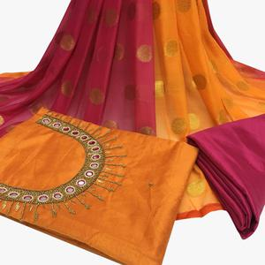 Regal Orange Colored Partywear Embroidered Santoon Dress Material