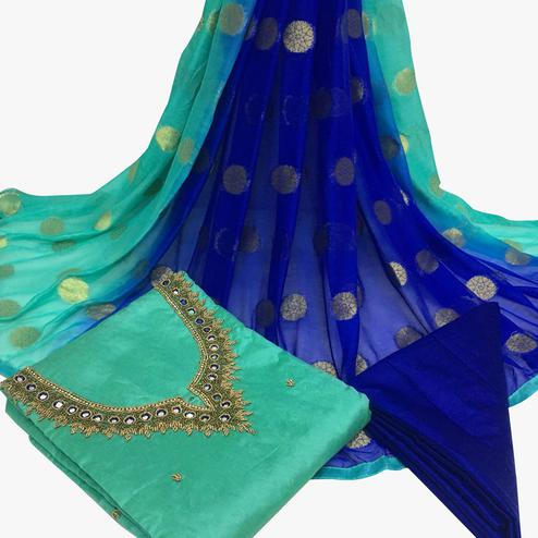 Magnificent Turquoise Green Colored Partywear Embroidered Santoon Dress Material