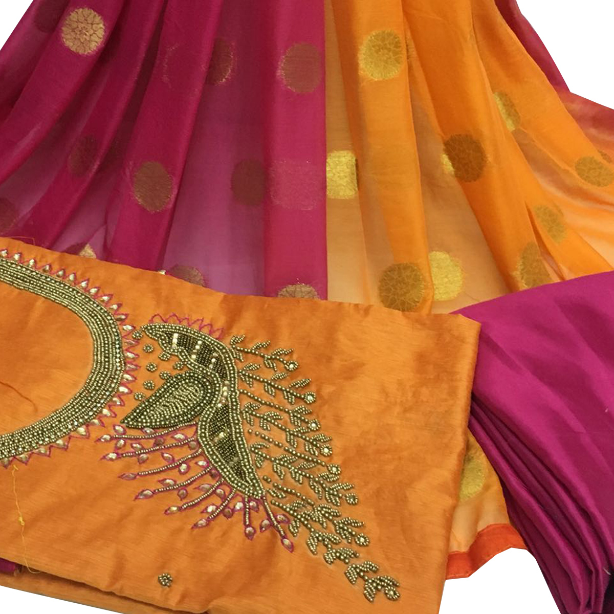 Blissful Orange Colored Partywear Embroidered Santoon Dress Material