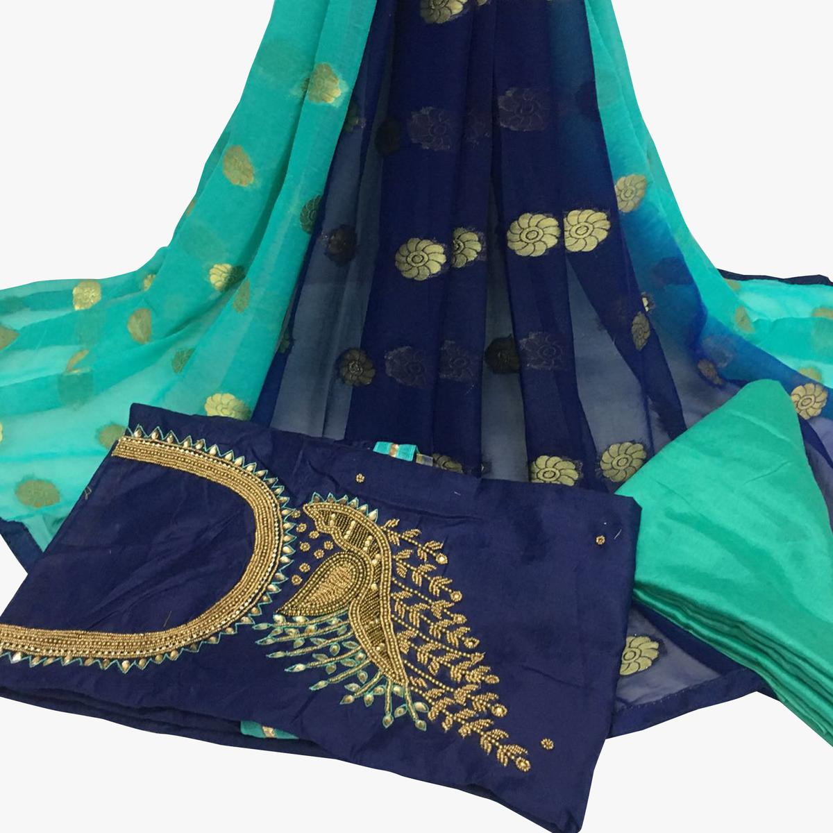 Remarkable Navy Blue Colored Partywear Embroidered Santoon Dress Material