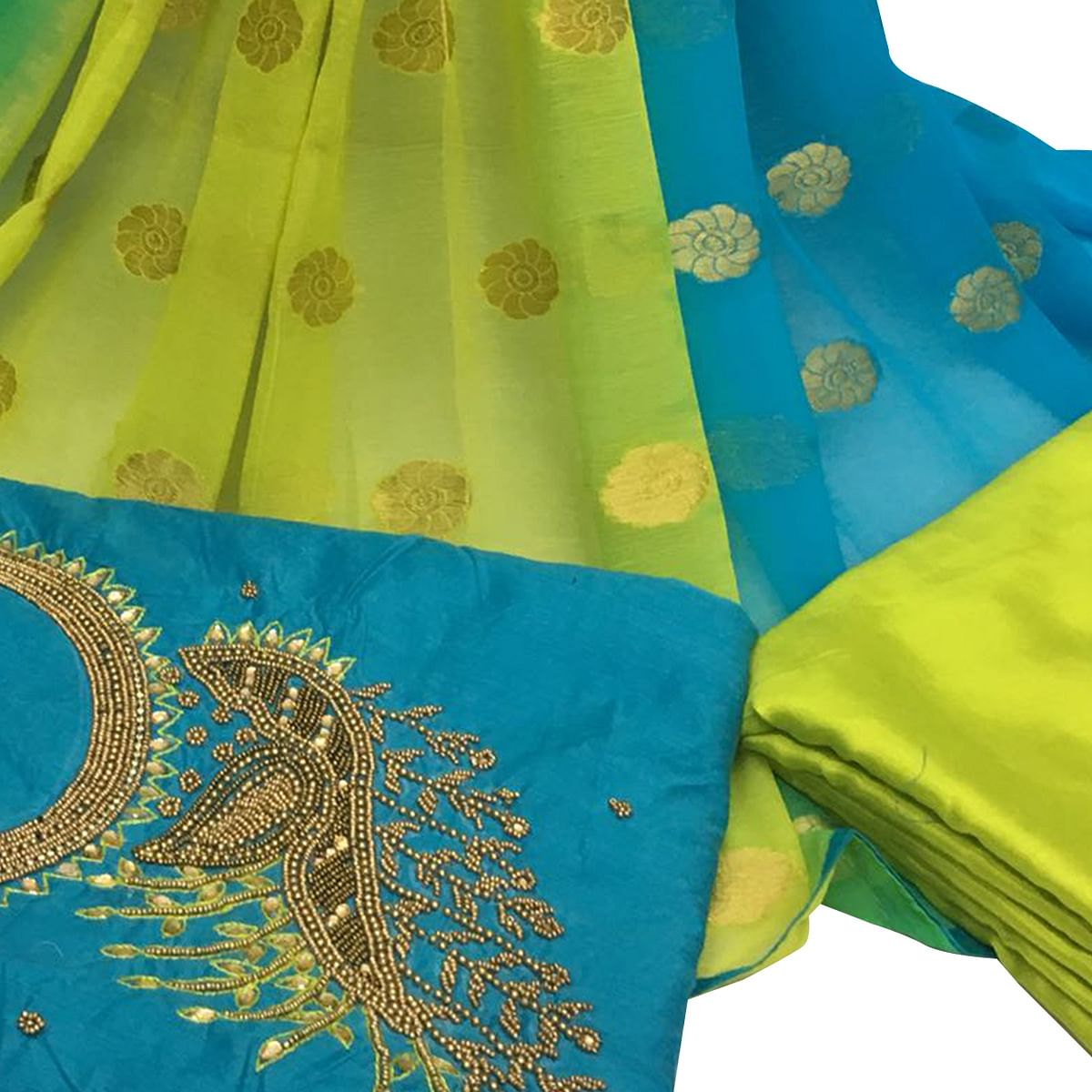 Flattering Sky Blue Colored Partywear Embroidered Santoon Dress Material