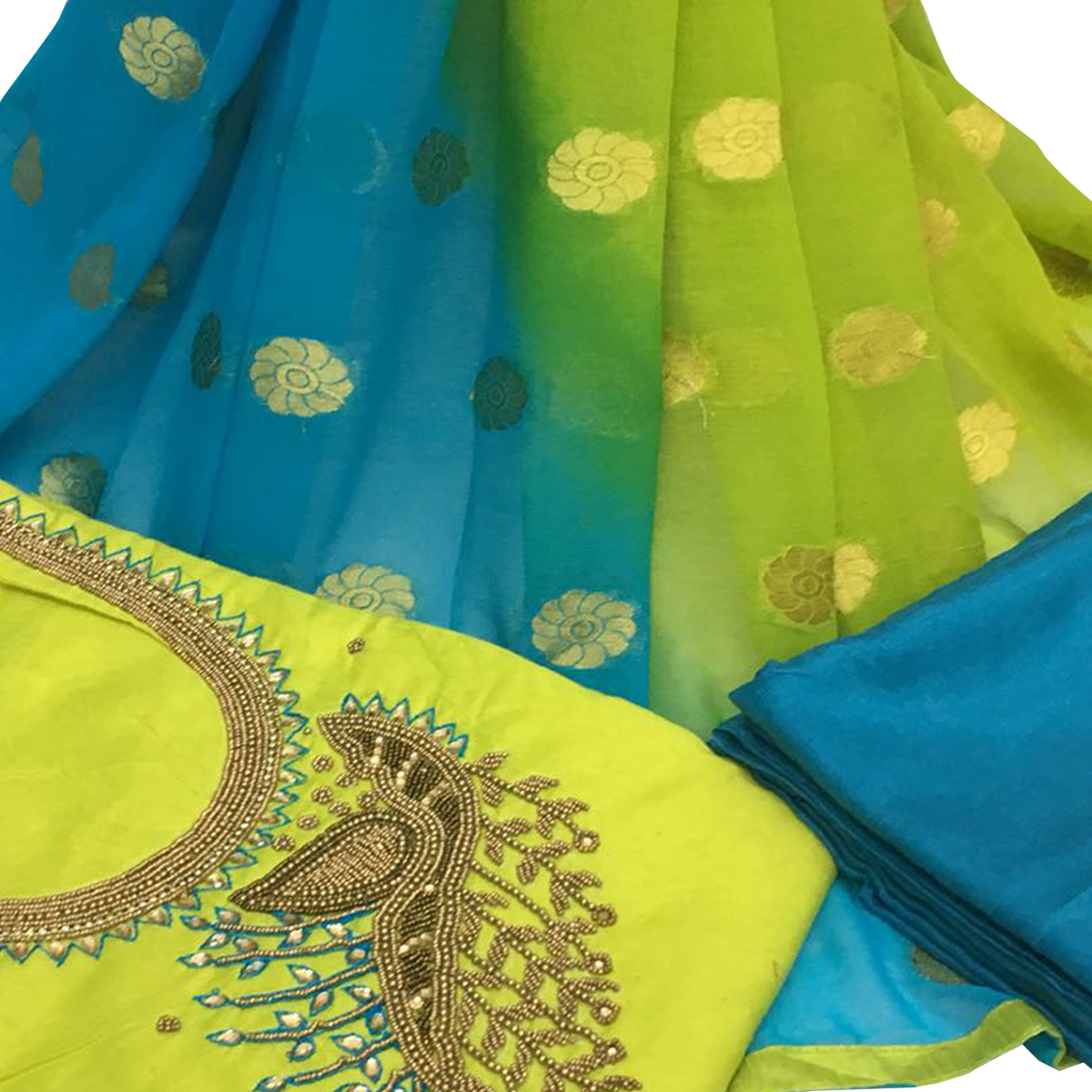 Riveting Green Colored Partywear Embroidered Santoon Dress Material