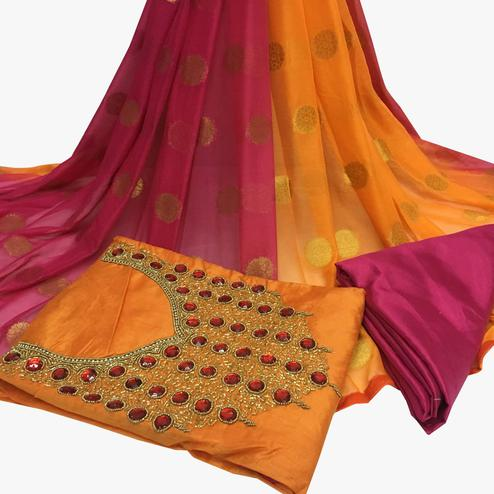 Desirable Orange Colored Partywear Embroidered Santoon Dress Material