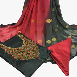 Staring Gray Colored Partywear Embroidered Santoon Dress Material