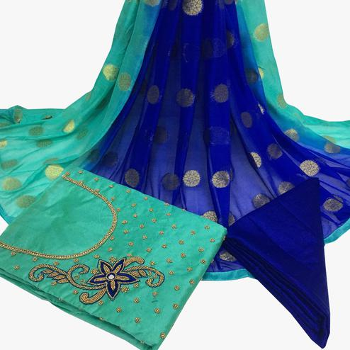 Gleaming Turquoise Green Colored Partywear Embroidered Santoon Dress Material