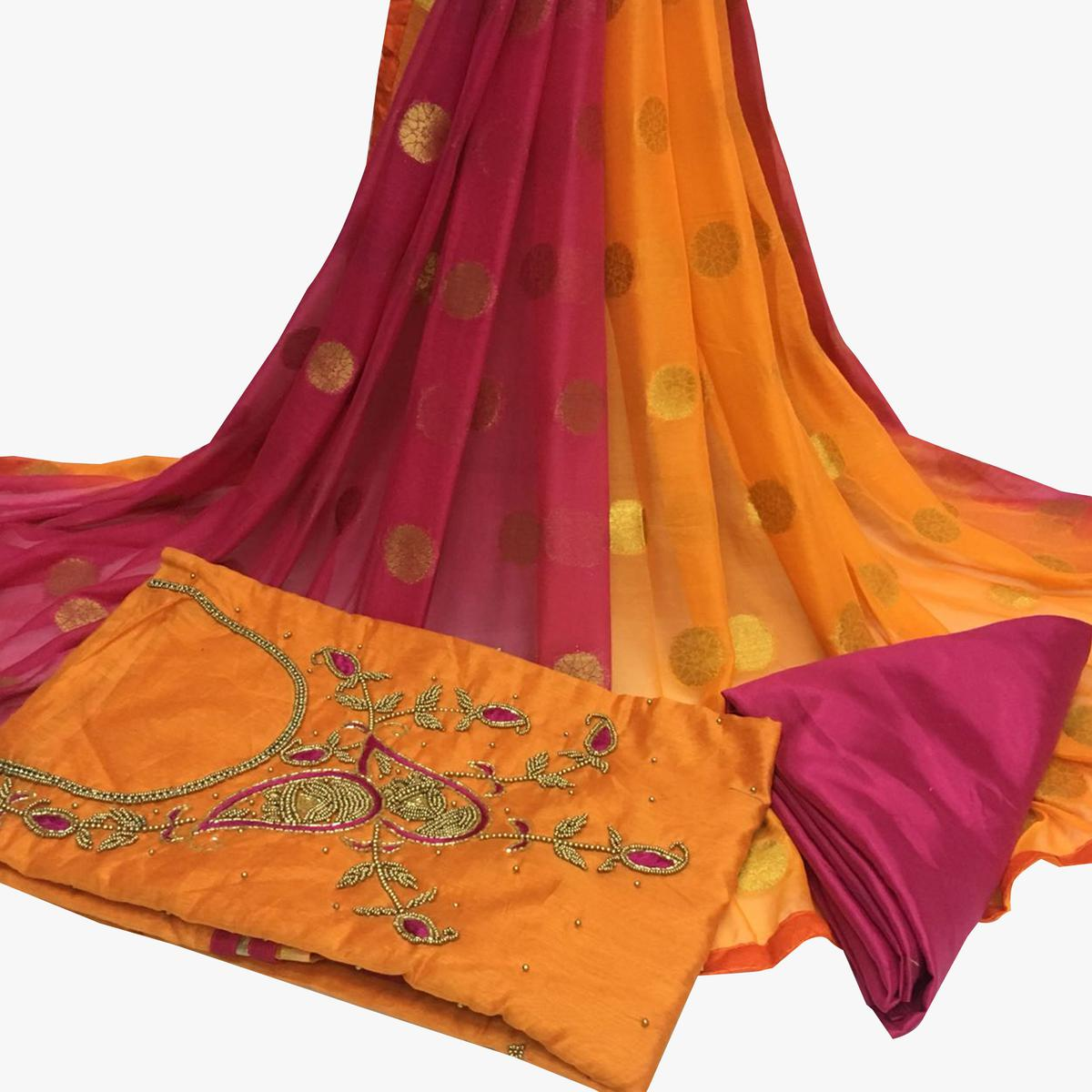 Engrossing Orange Colored Partywear Embroidered Santoon Dress Material