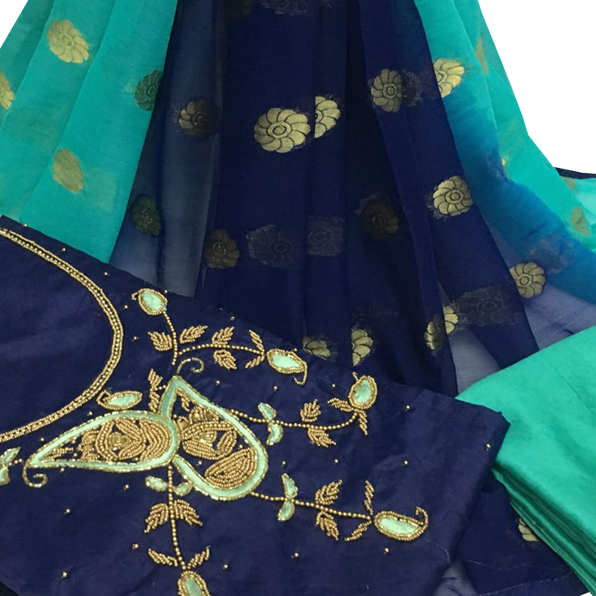 Fabulous Navy Blue Colored Partywear Embroidered Santoon Dress Material
