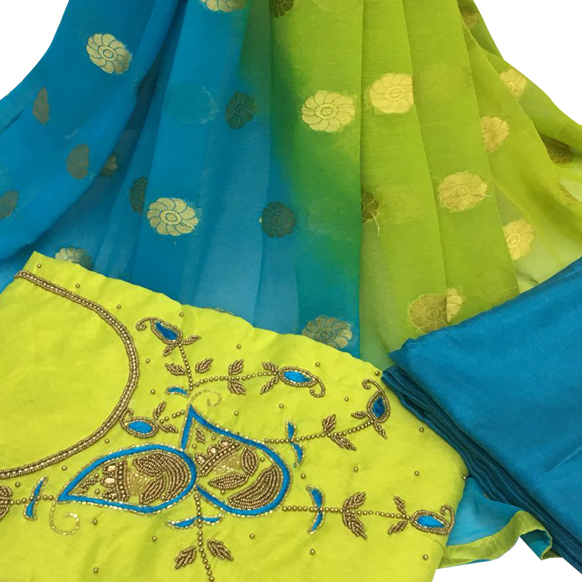 Superb Green Colored Partywear Embroidered Santoon Dress Material