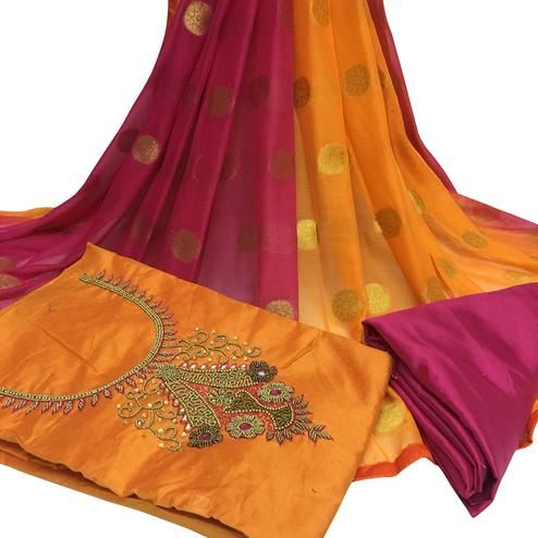 Amazing Orange Colored Partywear Embroidered Santoon Dress Material