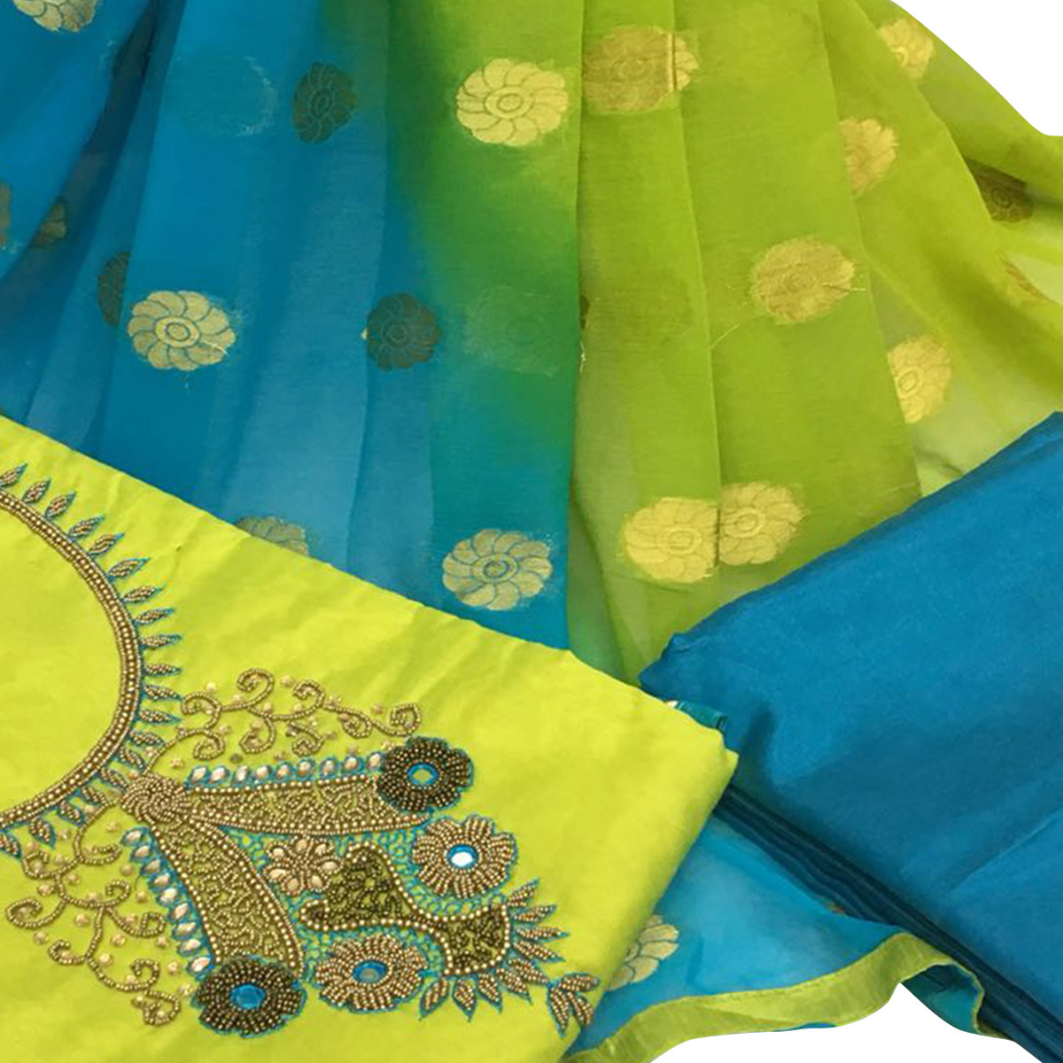 Gleaming Green Colored Partywear Embroidered Santoon Dress Material