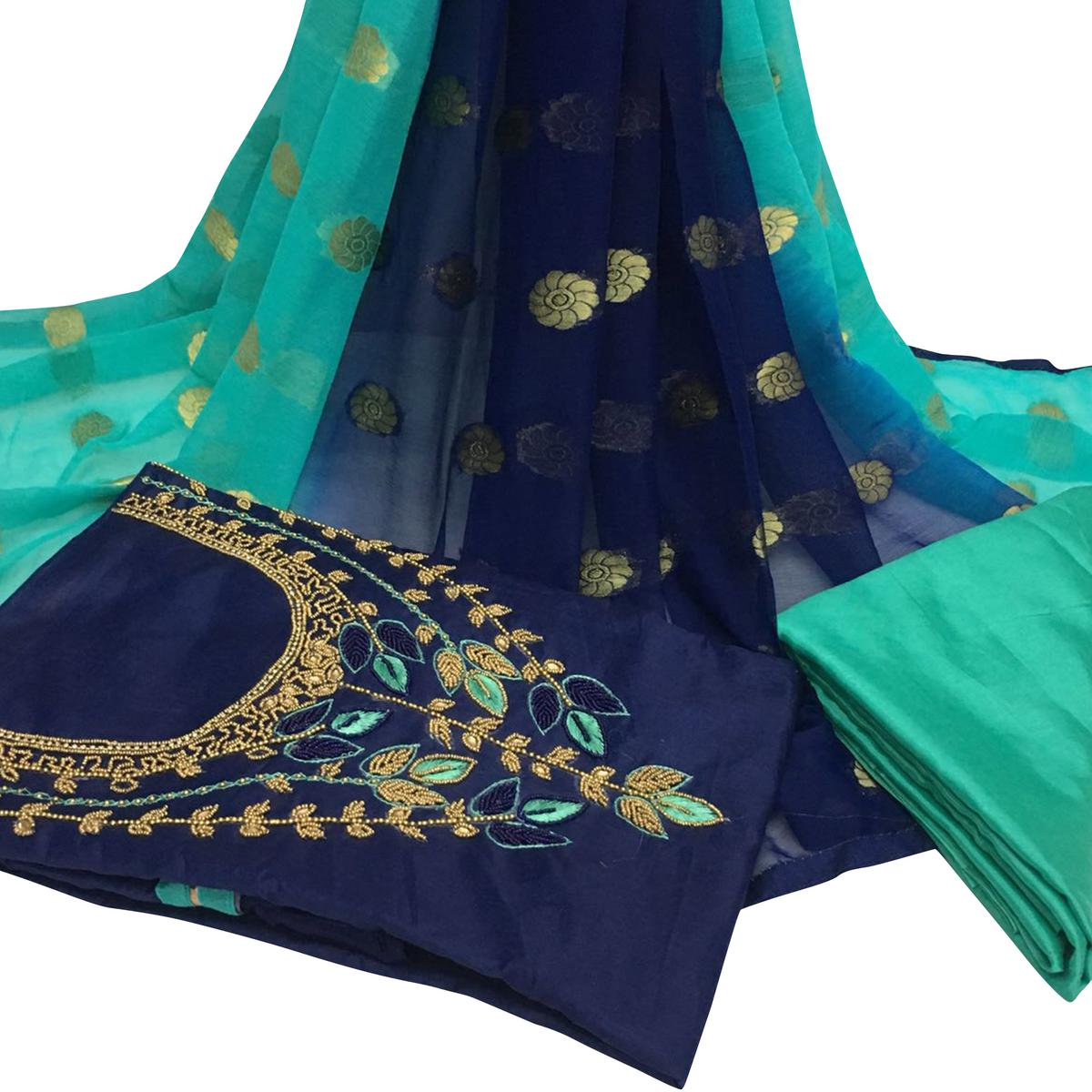Irresistible Navy Blue Colored Partywear Embroidered Santoon Dress Material