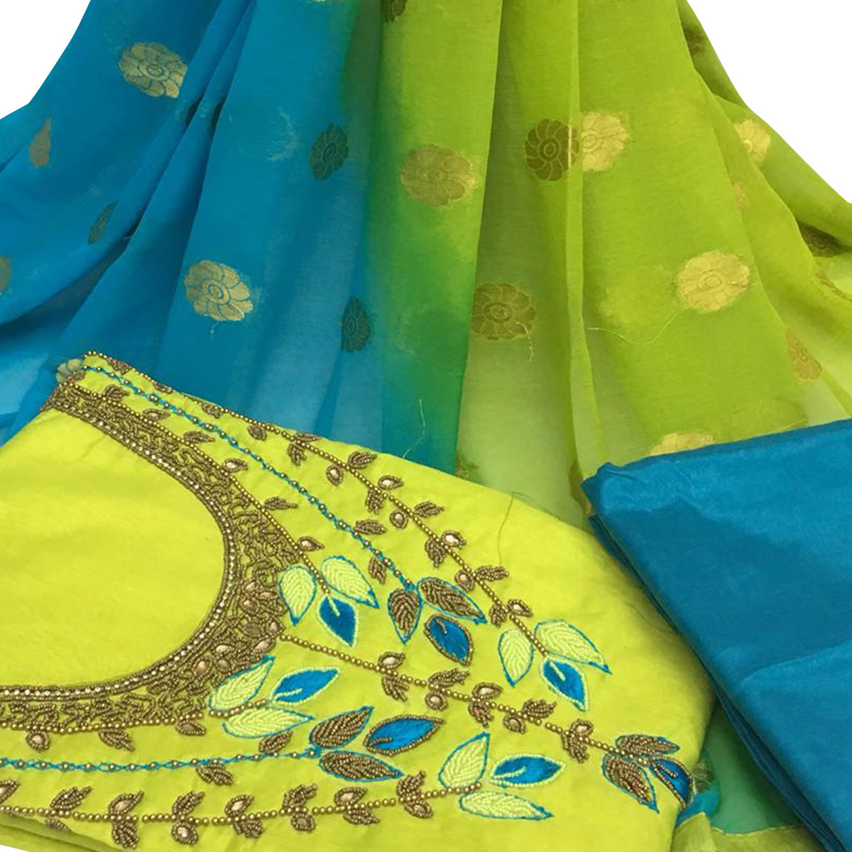 Adorning Green Colored Partywear Embroidered Santoon Dress Material