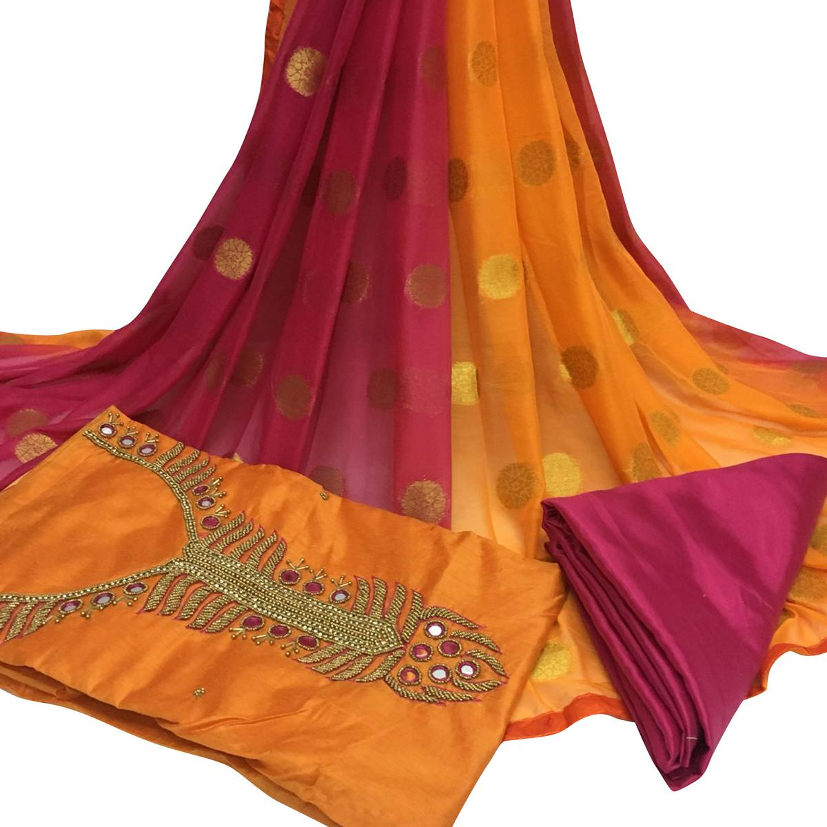 Stunning Orange Colored Partywear Embroidered Santoon Dress Material
