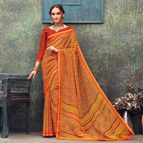 Ravishing Orange Colored Casual Wear Printed Chiffon Saree