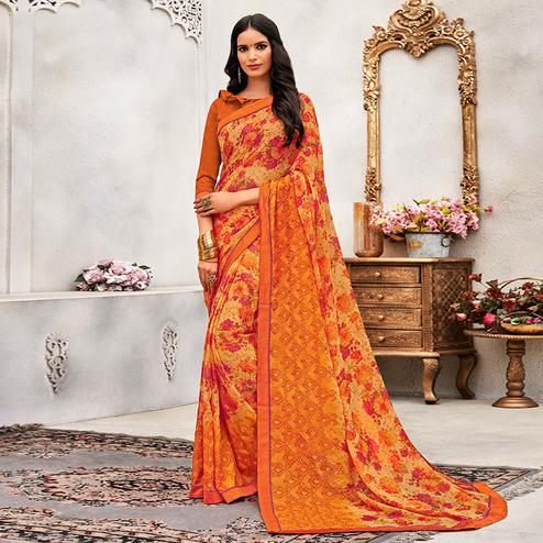 Amazing Orange Colored Casual Wear Printed Chiffon Saree