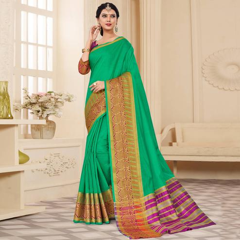 Gleaming Turquoise Green Colored Festive Wear Woven Cotton Silk Saree