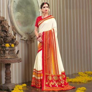 Mesmerising Cream Colored Festive Wear Patola Silk saree