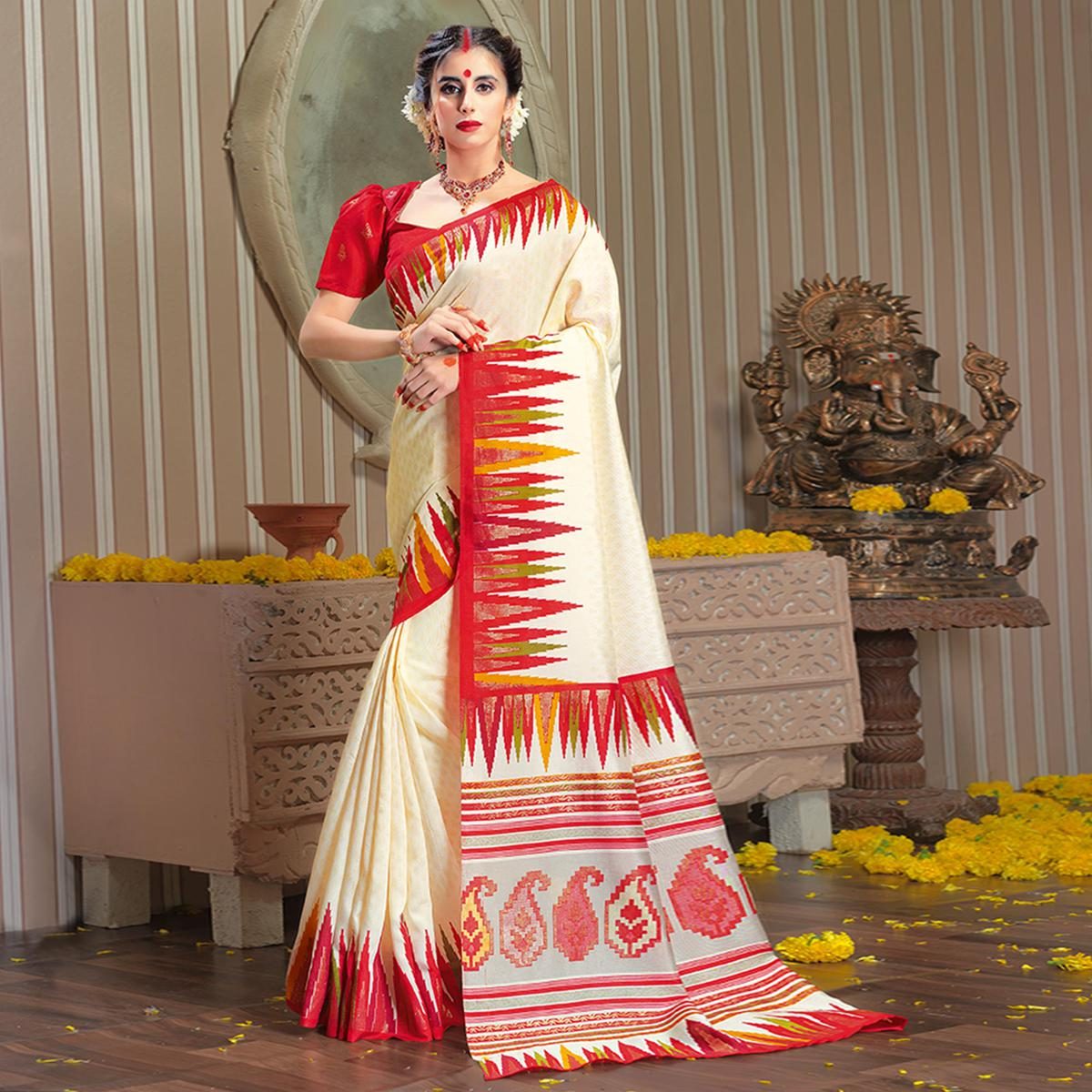 Majesty Cream Colored Festive Wear Patola Silk saree