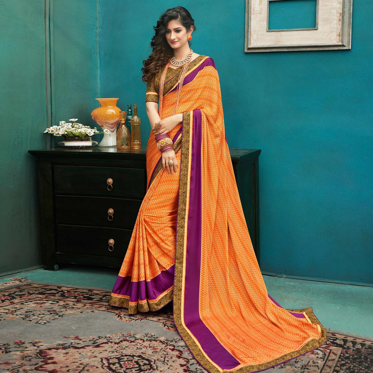 Gleaming Orange Colored Casual Printed Crepe Saree
