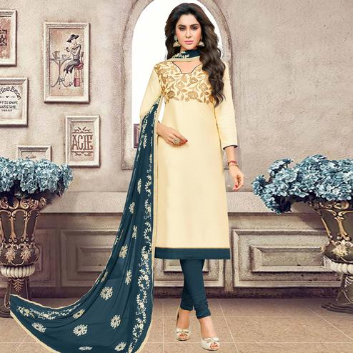 Appealing Cream Colored Partywear Embroidered Banarasi Silk Suit