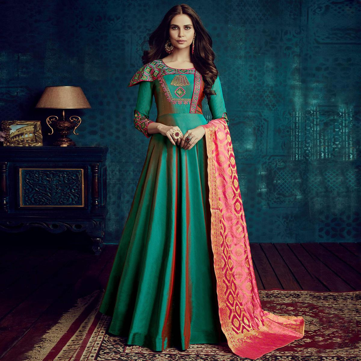 Capricious Green Colored Party Wear Embroidered Tapetta Silk Gown