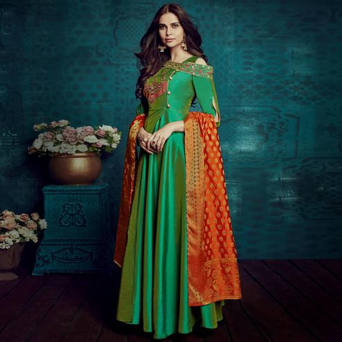 Impressive Green Colored Party Wear Embroidered Tapetta Silk Gown