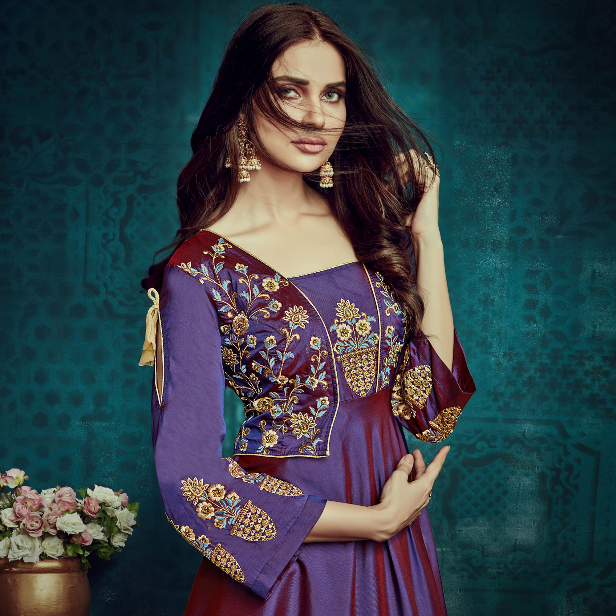 Gleaming Purple Colored Party Wear Embroidered Tapetta Silk Gown