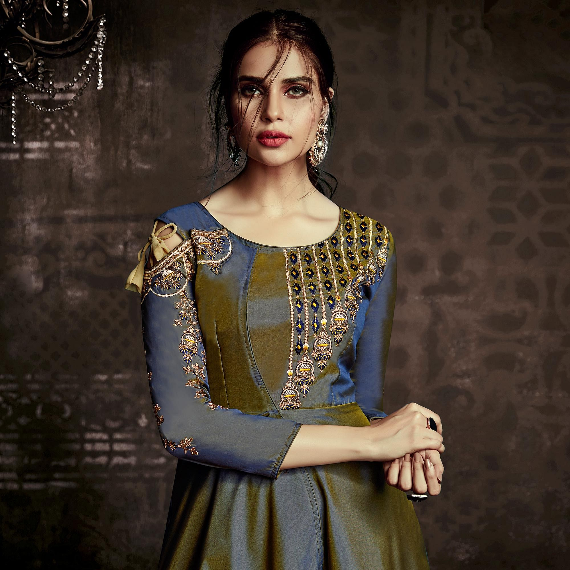 Gorgeous Mehendi Green Colored Party Wear Embroidered Tapetta Silk Gown