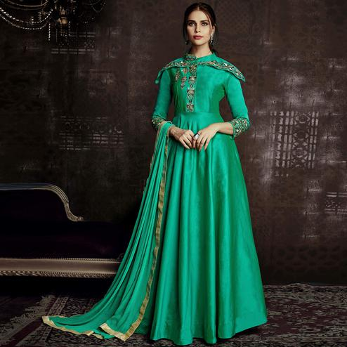 Classy Turquoise Green Colored Party Wear Embroidered Tapetta Silk Gown