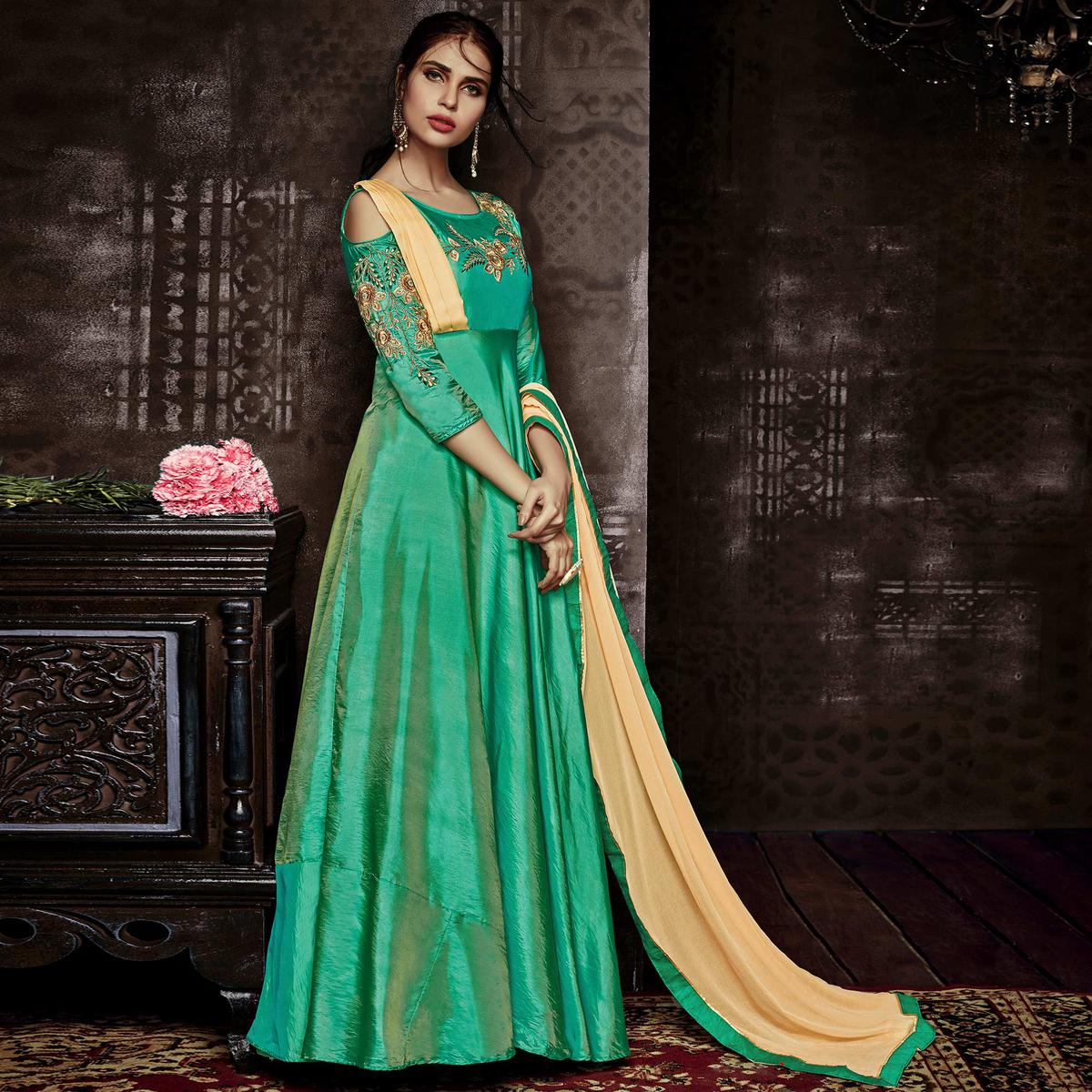 Pretty Turquoise Green Colored Party Wear Embroidered Tapetta Silk Gown