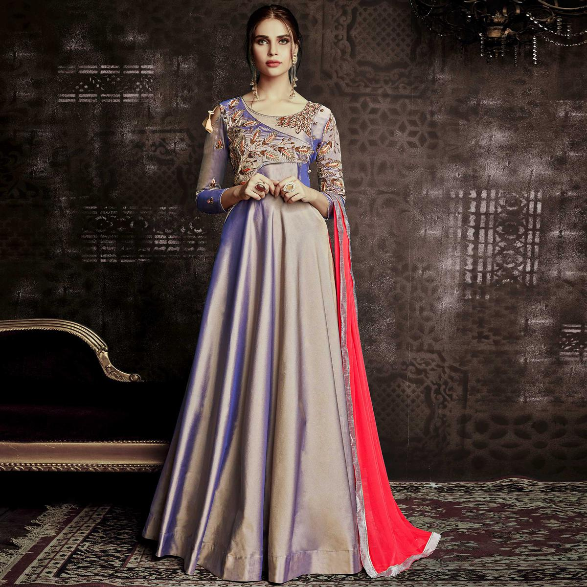 Charming Lavender Colored Party Wear Embroidered Tapetta Silk Gown
