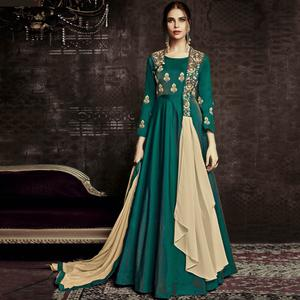 Ravishing Rama Green Colored Party Wear Embroidered Tapetta Silk Gown
