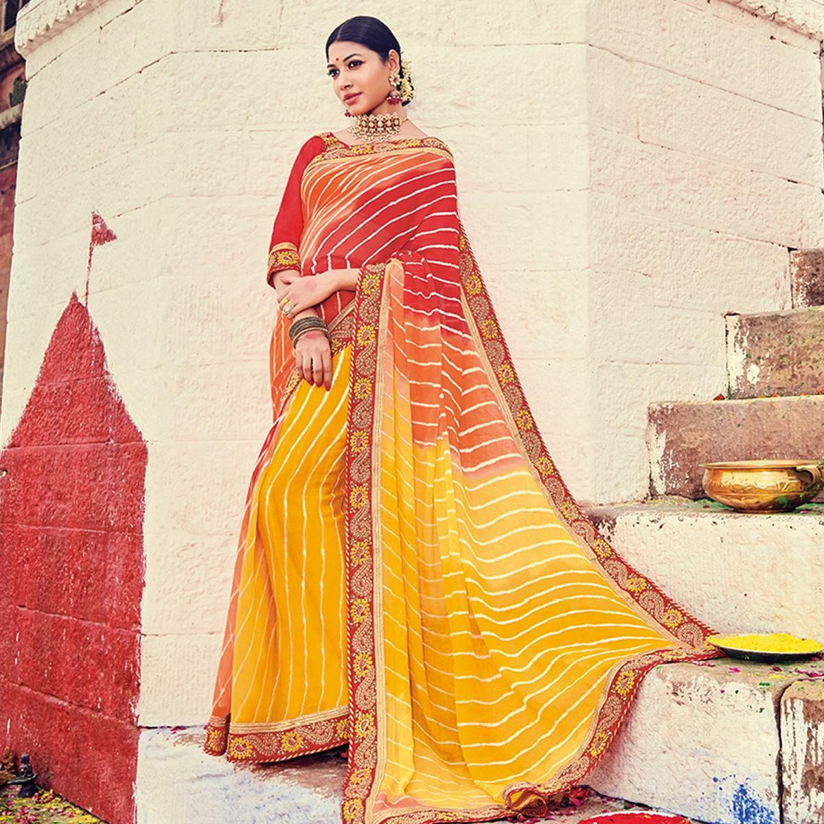 Graceful Yellow-Red Colored Party Wear Lehariya Printed Georgette Saree