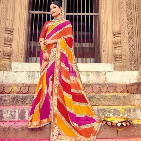 Charming Multicolored Party Wear Lehariya Printed Georgette Saree
