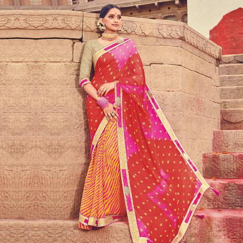 Amazing Yellow-Red Colored Party Wear Lehariya Printed Georgette Saree