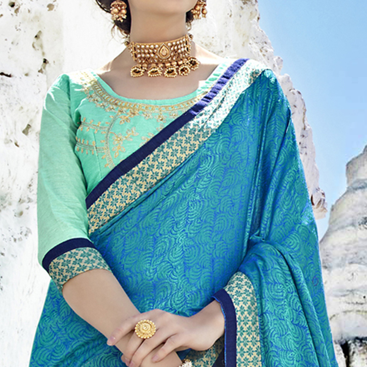 Staring Turquoise-Blue Colored Party Wear Embroidered Georgette Saree