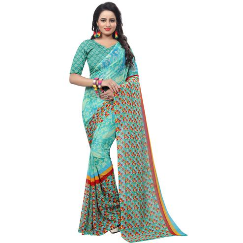 Stunning Turquoise Colored Casual Wear Printed Georgette Saree