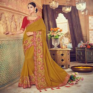 Desirable Mehandi Green Colored Party Wear Embroidered Silk Saree