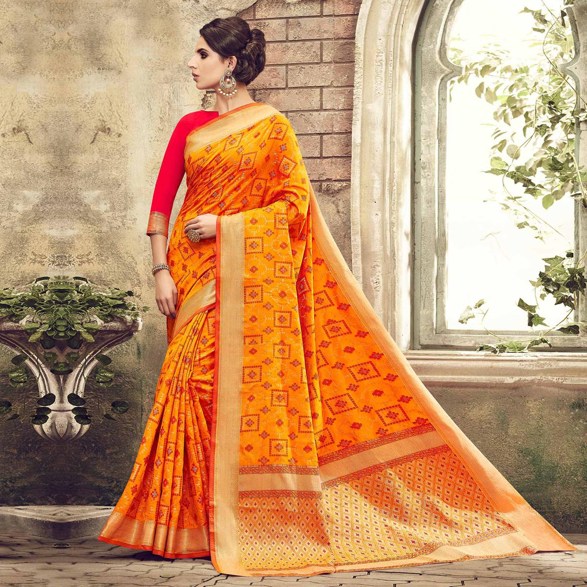 Impressive Orange Colored Festive Wear Patola Silk Saree