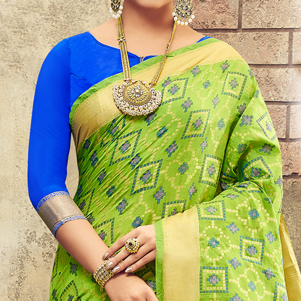 Gleaming Bright Green Colored Festive Wear Patola Silk Saree