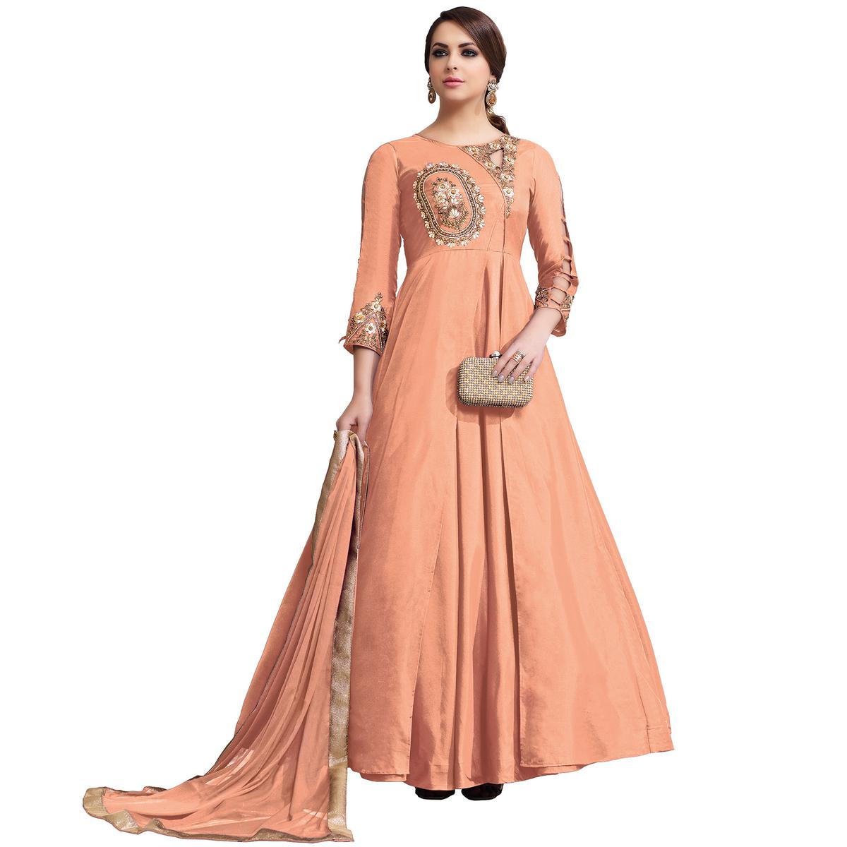 Appealing Light Orange Colored Partywear Embroidered Tapeta Silk Gown