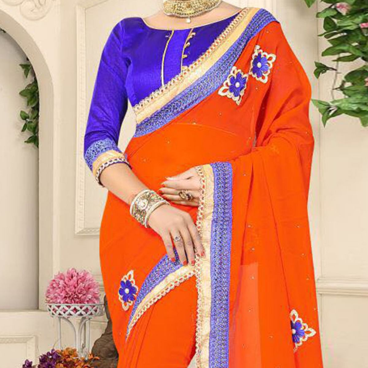 Flamboyant Orange Georgette Partywear Saree