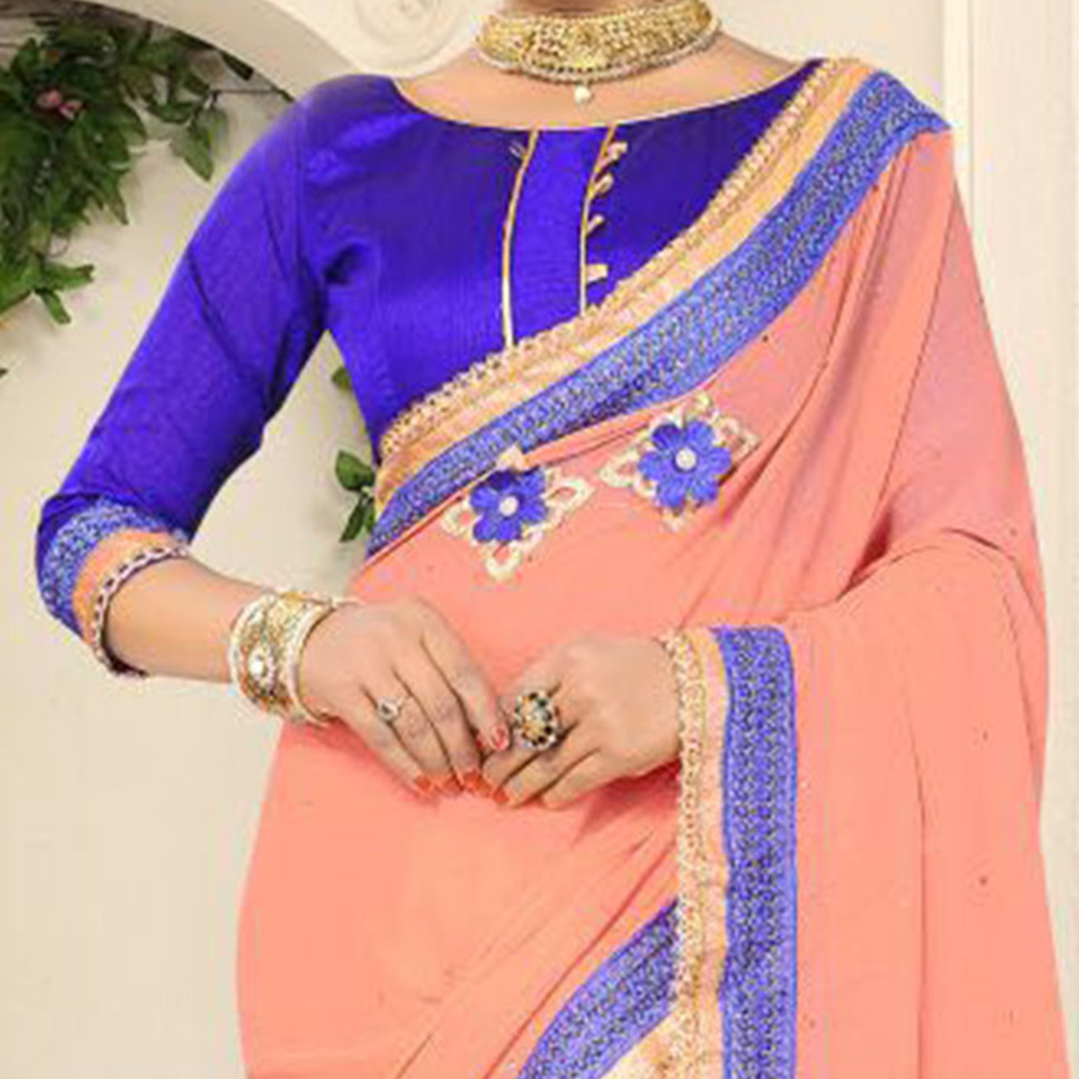 Charming Peach Georgette Partywear Saree