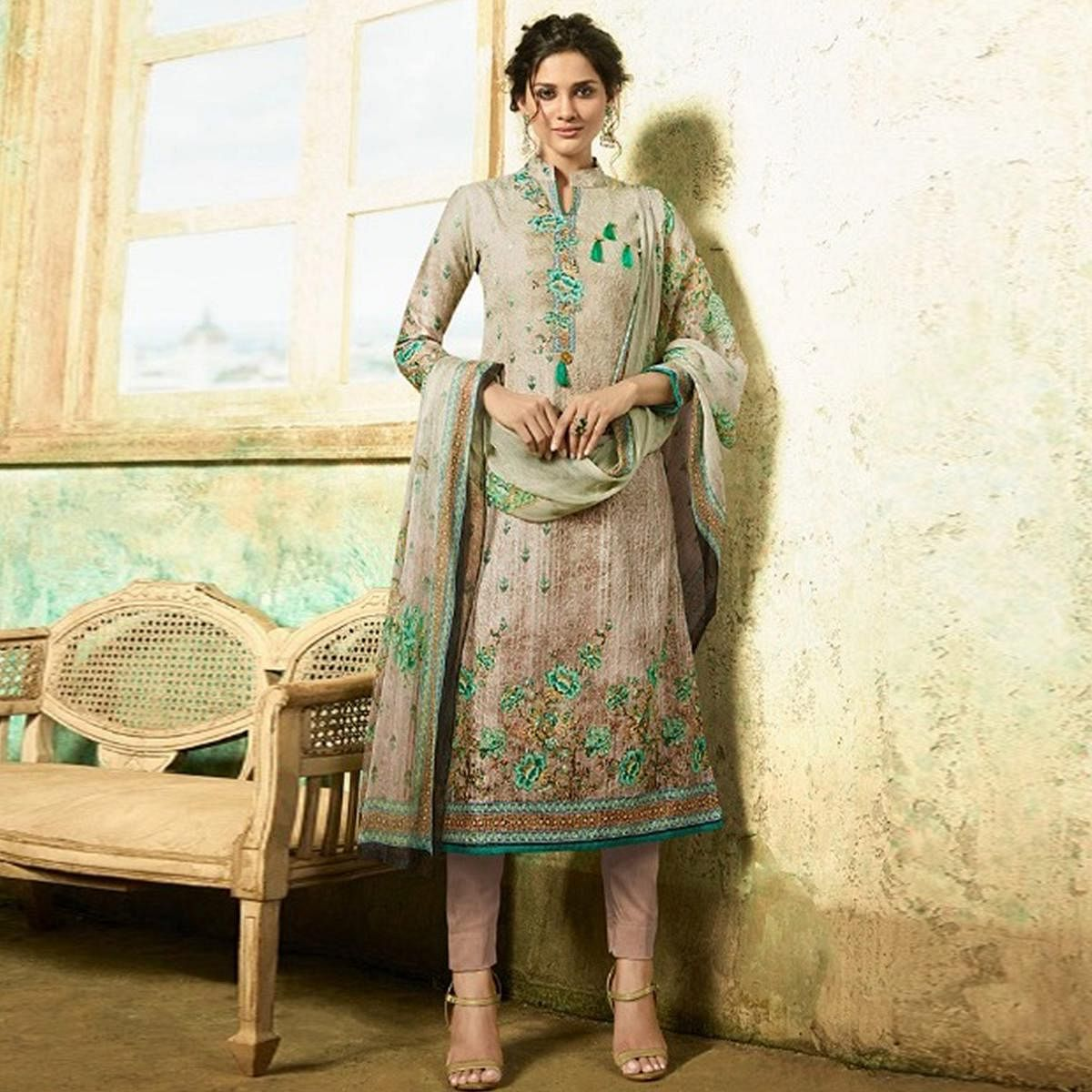 Stunning Beige Colored Partywear Embroidered Cotton Suit