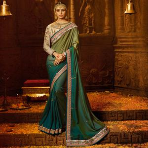 Demanding Turquoise Colored Party Wear Embroidered Silk Saree