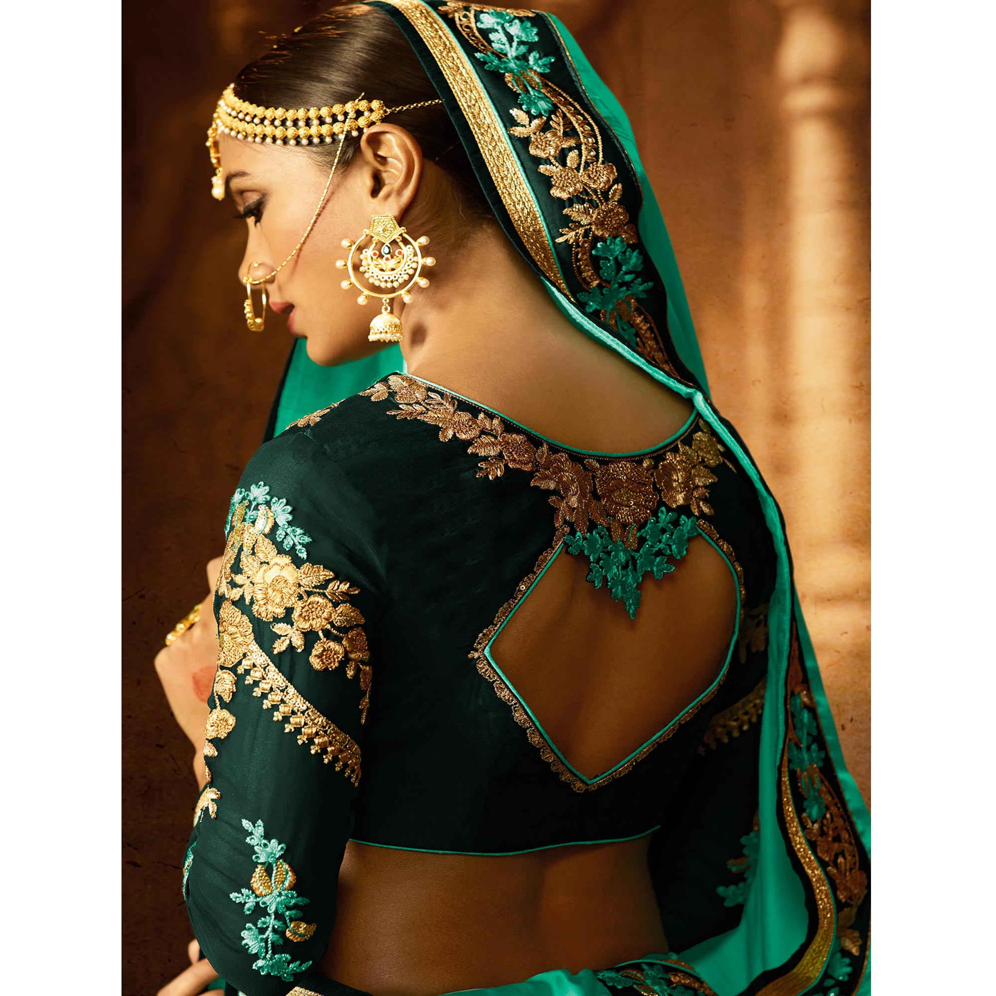Elegant Turquoise Green Colored Party Wear Embroidered Crepe Saree