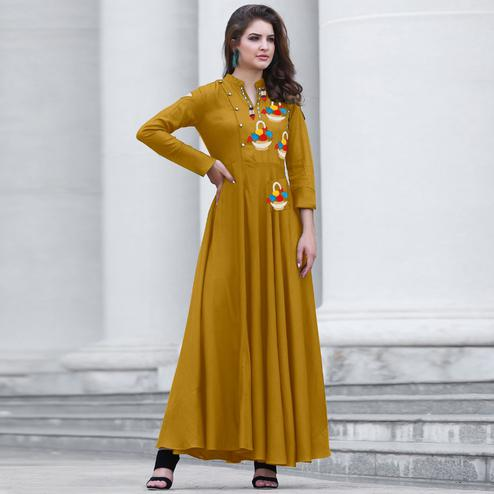 Adorning Yellow Colored Party Wear Embroidered Cotton Kurti